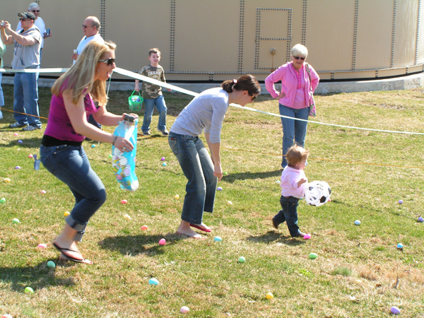 Adult helping with egg hunt