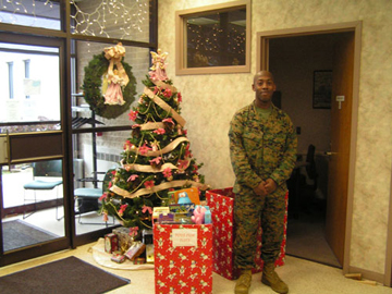 Soldier Standing by Boxes for Toys for Tots