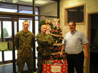 Three Men Standing by Box of Toys for Toys For Tots